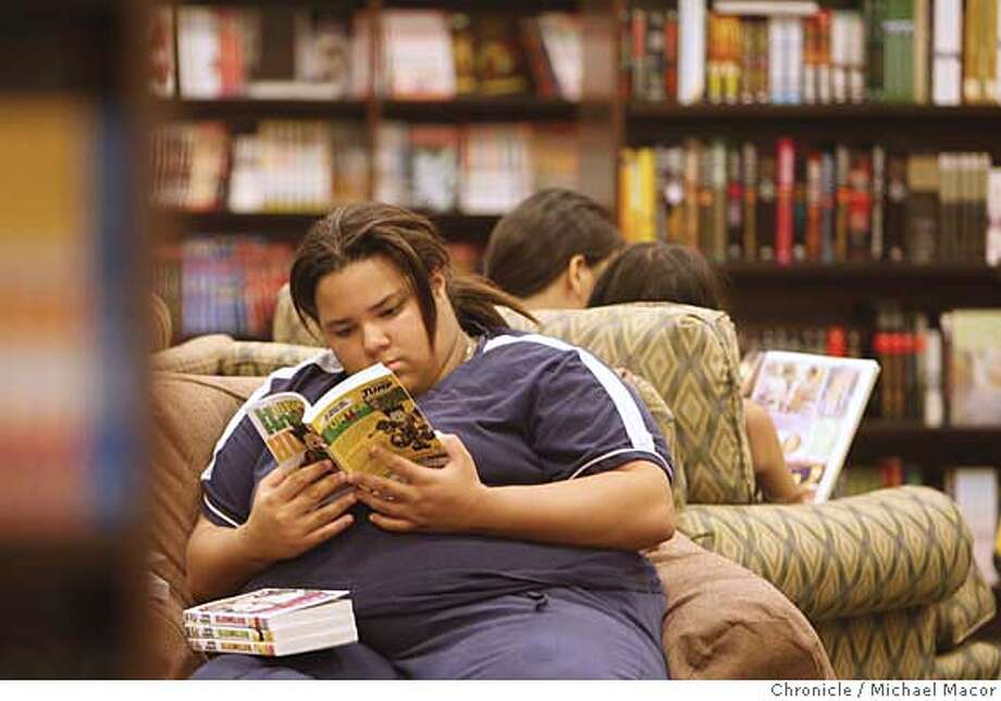 potter15_054_mac.jpg Karmelle Tatum, 14, enjoys reading the Manga graphic books. With the scheduled release of the 7th Harry Potter book next week, a look at the reading rates of children, a visit to the Barnes and Noble Bookstore in El Cerrito. Photographed in, El Cerrito, Ca, on 7/13/07. Photo by: Michael Macor/ The Chronicle Mandatory credit for Photographer and San Francisco Chronicle No sales/ Magazines Out Photo: Michael Macor