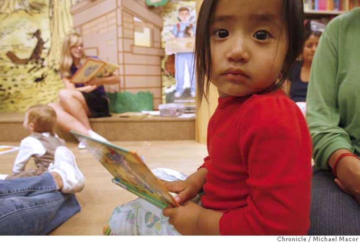potter15_045_mac.jpg 2 year old Tenzing Namdol with a book of her own, settles into storytime at Barnes and Noble as Genevieve McGuire reads a book out loud during story time at Barnes and Noble Bookstore. With the scheduled release of the 7th Harry Potter book next week, a look at the reading rates of children, a visit to the Barnes and Noble Bookstore in El Cerrito. Photographed in, El Cerrito, Ca, on 7/13/07. Photo by: Michael Macor/ The Chronicle Ran on: 07-15-2007 Karmelle Tatum, 14, reads manga graphic books at an El Cerrito bookstore. A new study says that the reading rates for children are in decline, as they are lured by electronic, entertainment media.