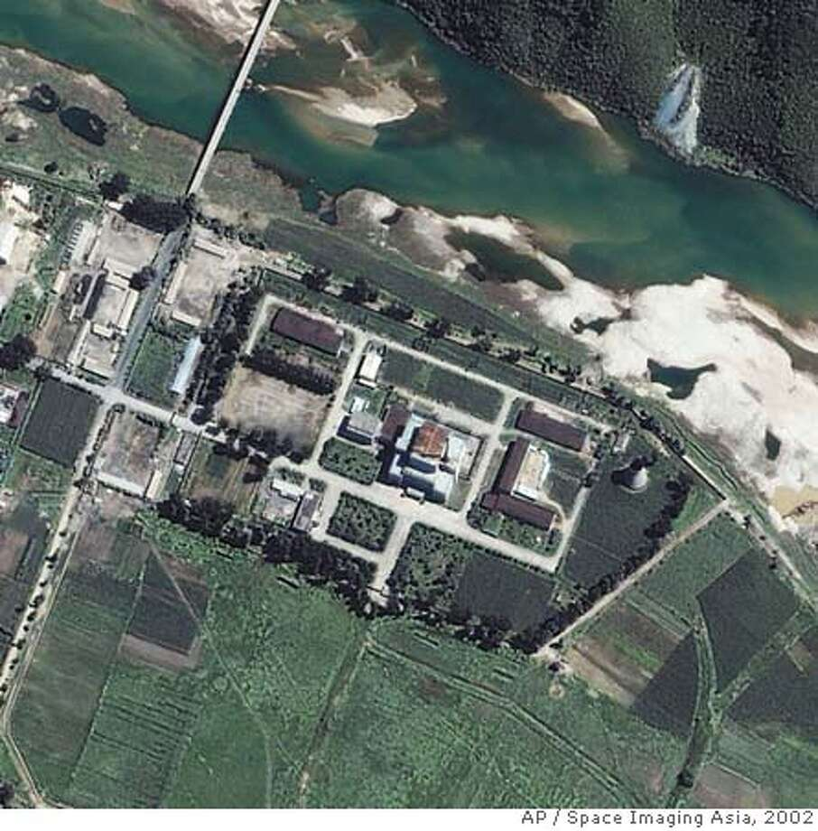** FILE ** This satellite image provided by Space Imaging Asia shows the Yongbyon Nuclear Center, located north of Pyongyang, North Korea, in this Aug. 13, 2002 file photo. U.S. envoy Christopher Hill said Friday June 22, 2007, that North Korea is prepared to promptly close down its Yongbyon nuclear reactor in line with its commitment earlier this year to do so. Hill, speaking at a press conference in Seoul following his return from the North, also said both the U.S. and North Korea reaffirmed their commitment to a February accord aimed at North Korea's denuclearization as well as an early meeting of nuclear envoys. (AP Photo/Space Imaging Asia, File) Photo: X