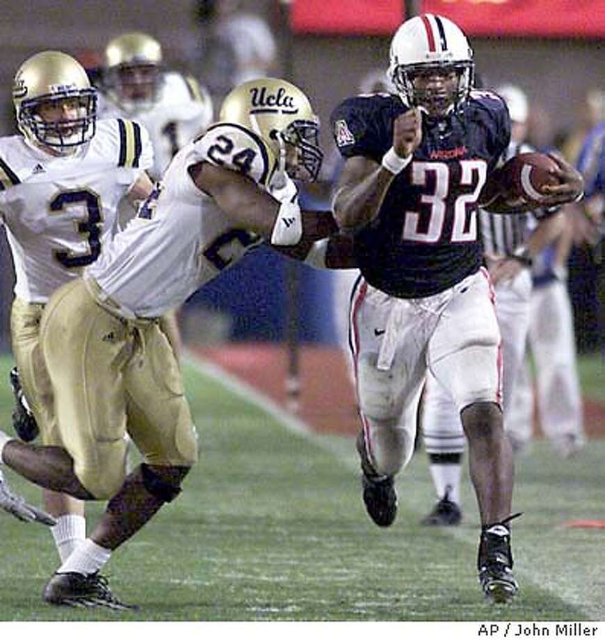 Arizona's Clarence Farmer (32) is pushed out of bounds by UCLA's Ben Emanuel (24) after a long gain during the third quarter in Tucson, Ariz., Saturday, Oct. 11, 2003. (AP Photo/John Miller) Photo: JOHN MILLER