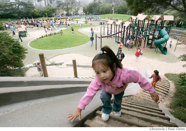Amy Eslava, 4, reaches the top of the concrete slide at the Children's Playground which reopened at Golden Gate Park in San Francisco, Calif. on Saturday, July 14, 2007. The $3.8 million renovation project on the playground, that originally opened in 1887, took a year-and-a-half to complete.  PAUL CHINN/The Chronicle  **Amy Eslava Photo: PAUL CHINN