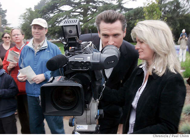 Mayor Gavin Newsom peeks into a television news camera set-up to record the reopening of the Children's Playground at Golden Gate Park in San Francisco, Calif. on Saturday, July 14, 2007. The $3.8 million renovation project on the playground, that originally opened in 1887, took a year-and-a-half to complete.  PAUL CHINN/The Chronicle  **Gavin Newsom Photo: PAUL CHINN