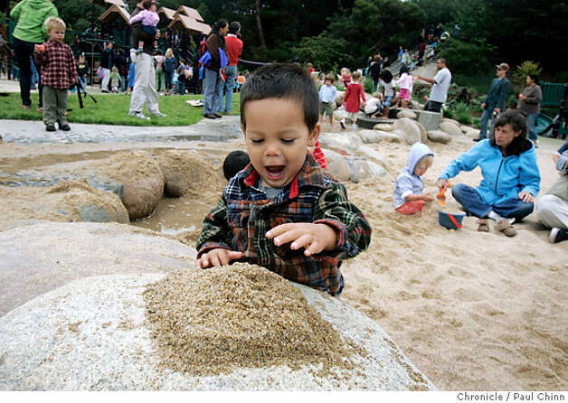 Brandon Buerger, 2, played with a pile of sand when the Children's Playground reopened at Golden Gate Park in San Francisco, Calif. on Saturday, July 14, 2007. The $3.8 million renovation project on the playground, that originally opened in 1887, took a year-and-a-half to complete.  PAUL CHINN/The Chronicle  **Brandon Buerger Photo: PAUL CHINN