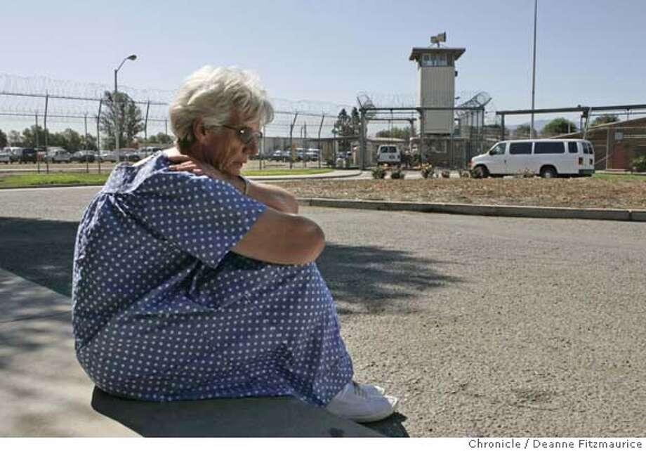 joyce_059_df.jpg  Joyce Walker, 65, sits on a curb at the California Institution for Women in Corona, on her last day there after 16 years. She is waiting for a bus to pick her up and transport her to Pomona jail before her court appearance where a judge granted her release. She was released from prison with the help of the California Habeas Project, after serving 16 years for the murder of her husband. Photographed in Pomona on 4/25/07. Deanne Fitzmaurice / The Chronicle after serving 16 yea5rs  Ran on: 07-15-2007  Joyce Walker, 65, waits inside the Corona prison for a ride to a Pomona court appearance that would eventually free her. Photo: Deanne Fitzmaurice