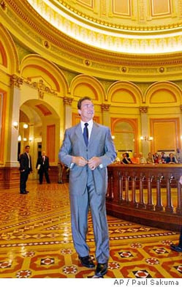Gov.-elect Arnold Schwarzenegger walks through the rotunda of the state Capitol during a visit to legislators in Sacramento, Calif., Wednesday, Oct. 22, 2003. Schwarzenegger used his first official visit to the state Capitol Wednesday to name a health care executive and former aide to Republican former Gov. Pete Wilson as his new chief of staff. (AP Photo/Paul Sakuma) Photo: PAUL SAKUMA