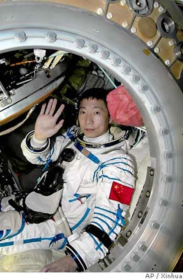 Yang Liwei, China's first astronaut, waves after his capsule landed in Mongolia on Oct. 16, 2003. Associated Press file photo, 2003, by Xinhua