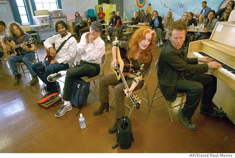 Tom Waits, Bonnie Raitt, Norton Buffalo, Jason Newsted and Austin Willarcy (right to left) take part in jam session at the Spring Valley Elementary School in downtown San Francisco on October 21, 2003. They were there to support the program which was started by David Wish in November 1996 and is a non-profit organization that provides free instruments and lessons to disadvantaged kids in public schools. Some of the artists that serve as board members are Bonnie Raitt, Paul Simon, BB King and Les Paul as well as frined Carlos Santana, Bob Weir and the band, Phish among others . (AP Photo/ David Paul Morris) Photo: David Paul Morris