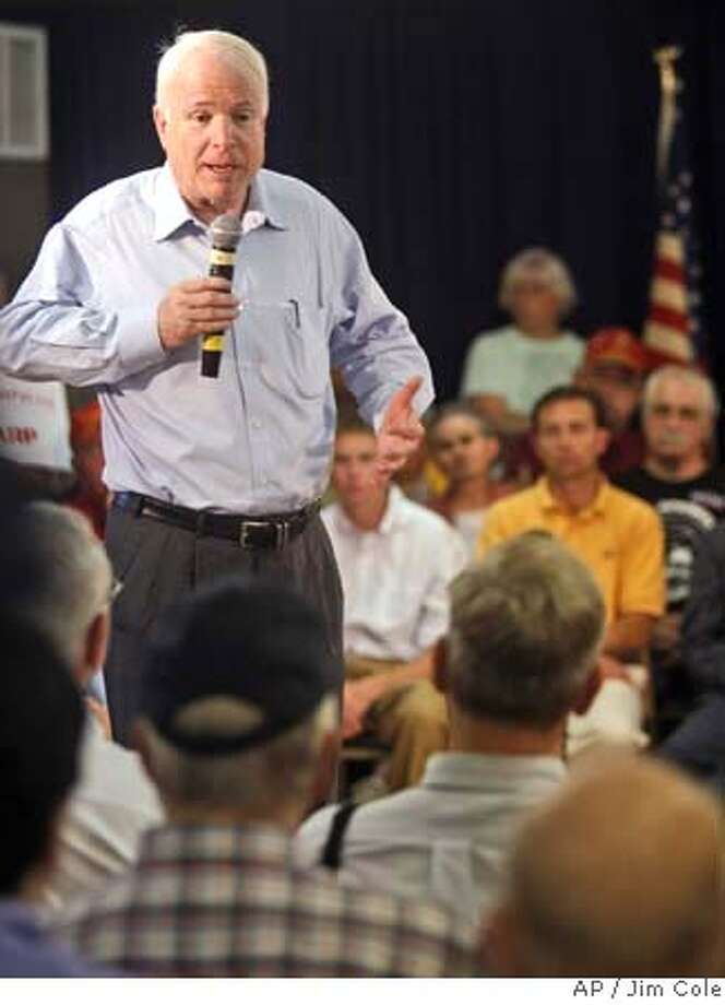 Republican presidential hopeful U.S. Sen. John McCain, of Arizona, answers questions during a campaign stop in Claremont, N.H., Saturday, July 14, 2007. (AP Photo/Jim Cole) Photo: Jim Cole