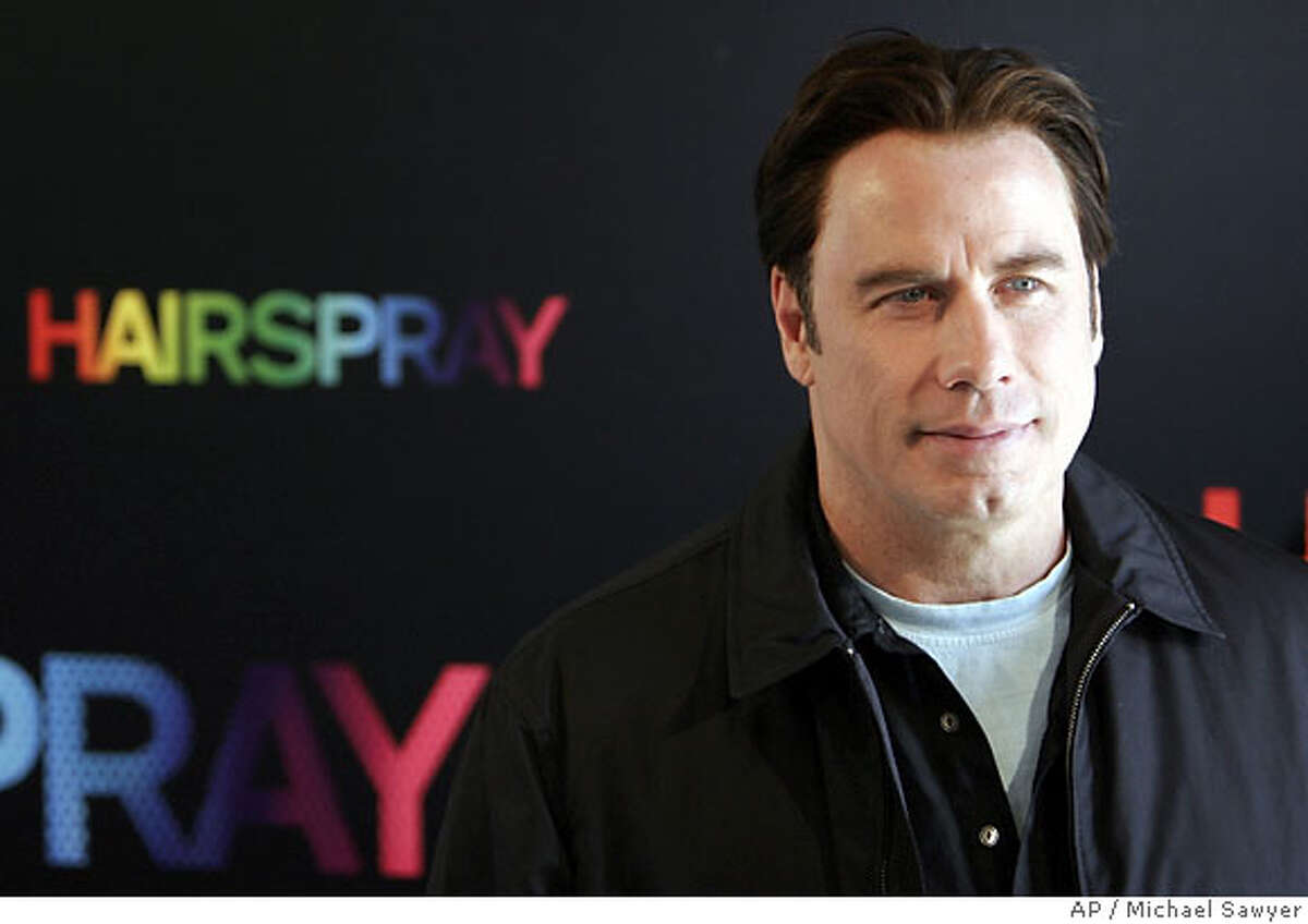 """U.S. actor John Travolta in Paris, Saturday, June 23, 2007, for the promotion of """"Hairspray"""", a new film to open in July. Travolta portrays Ms. Edna Turnblad in """"Hairspray,"""" the adaptation of the stage musical that was spun from the 1988 John Waters film of the same name. """"Hairspray,"""" a New Line release, also stars Christopher Walken, Michelle Pfeiffer and Queen Latifah. (AP Photo/Michael Sawyer)"""