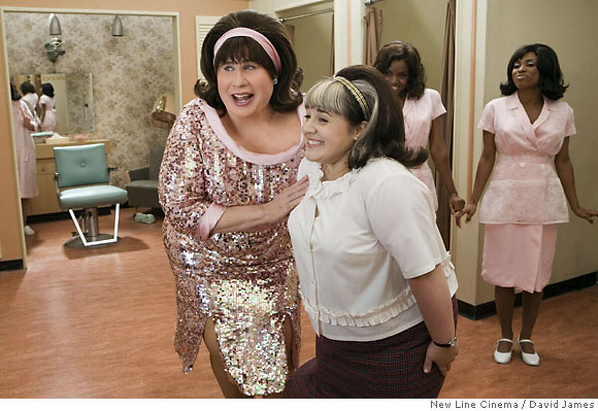 HS-03420 HS_03420F � John Travolta (left) stars as �Edna Turnblad� and Nikki Blonsky (right) stars as �Tracy Turnblad� in New Line Cinema�s musical, HAIRSPRAY. Photo courtesy David James/New Line Cinema Ran on: 07-15-2007 Nikki Blonskys life is similar to that of the character she portrays in Hairspray.