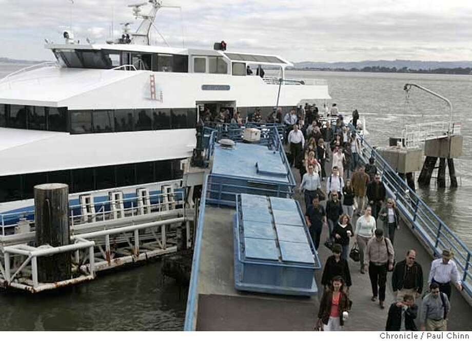 Commuters disembark from the Golden Gate Transit ferry Mendocino when it arrived from Larkspur at the Ferry Building in San Francisco, Calif. on Thursday, July 12, 2007. The transit agency is considering whether to purchase cleaner running high-speed boats or the reliable but more polluting diesel model.  PAUL CHINN/The Chronicle  Ran on: 07-14-2007  Commuters disembark at the Ferry Building in San Francisco from the Golden Gate Transit ferry Mendocino. Photo: PAUL CHINN