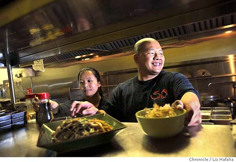 Restaurant review of So, 2240 Irving St.. James Chu, head chef and owner of the family business. On left is his fiancee, Christine Wu. He just made sauteed shredded pork with jalapenos, onions and green onion is a spicy garlic sauce (left), and fried tofu (right). Shot on 10/16/03 in San Francisco. LIZ HAFALIA / The Chronicle Photo: LIZ HAFALIA