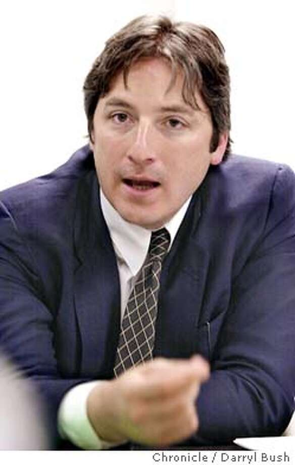 """Candidate for mayor, Matt Gonzalez, talks to a meeting held by disibility advocacy organization called """"People First."""" 10/17/03 in San Francisco. DARRYL BUSH / The Chronicle Photo: DARRYL BUSH"""