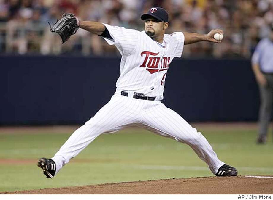 Minnesota Twins Johan Santana throws against the Oakland Athletics in first inning of a baseball game Friday, July 13,2007 in Minneapolis. Santana pitched seven shutout innings, giving up four hits. (AP Photo/Jim Mone) Photo: Jim Mone