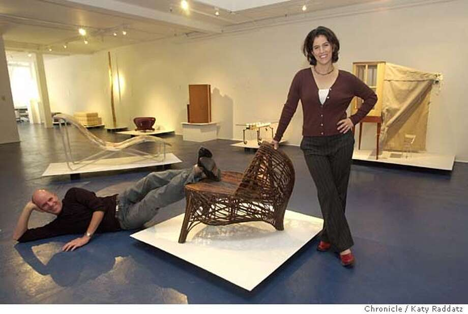 """Mark Waldo and Maria Mortati are new curators collaborating on a show at the Blue Room Gallery called Bay Area Furniture Art. SHOWN: Mark Waldo (lying down) and Maria Mortati in the gallery; they're leaning on """"Egg 2"""" a willow chair by Dave Chapman. Many other (though not all) pieces from the show are in the background.. KATY RADDATZ / The Chronicle Photo: KATY RADDATZ"""