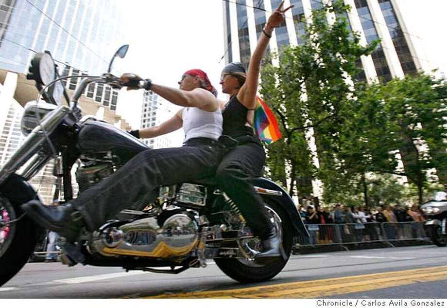 prideparade26001_cag.jpg  Members of Dykes on Bikes ride down Market Street in San Francisco, Ca., on Sunday, June 25, 2006 for the 36th Annual Gay Pride Parade.  Photographed in San Francisico  Carlos Avila Gonzalez/The Chronicle Ran on: 06-26-2006  Kevin Heuer (left) and Todd Leichleiter are a contingent of two as the parade makes its way through downtown San Francisco.  Ran on: 06-26-2006  Kevin Heuer (left) and Todd Leichleiter are a contingent of two as the parade makes its way through downtown San Francisco. MANDATORY CREDIT FOR PHOTOG /NO SALES Photo: Carlos Avila Gonzalez