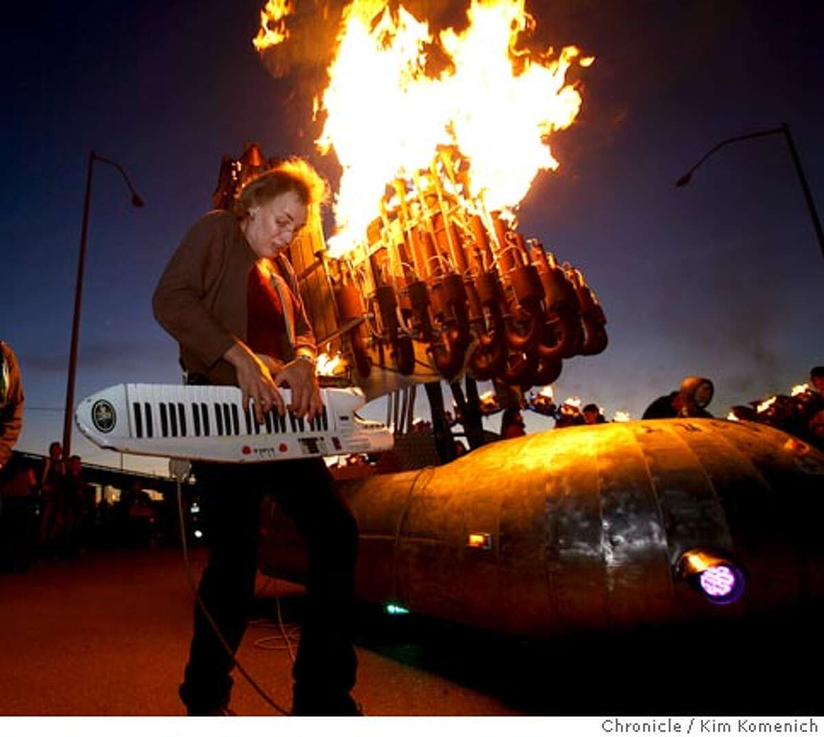 """""""Lucyfer"""" (Lucy Hosking of Santa Cruz) plays """"Satan's Calliope"""" in Oakland Thursday night at the seventh annual Fire Arts Festival sponsored by The Crucible, an Oakland arts collective. The festival is an annual gathering of Burning Man artists who light their sculptures on fire in a West Oakland parking lot to preview the interactive pyrotechnic art they will be bringing to Burning Man in late August. Photo by Kim Komenich/The Chronicle **Lucy Hosking"""
