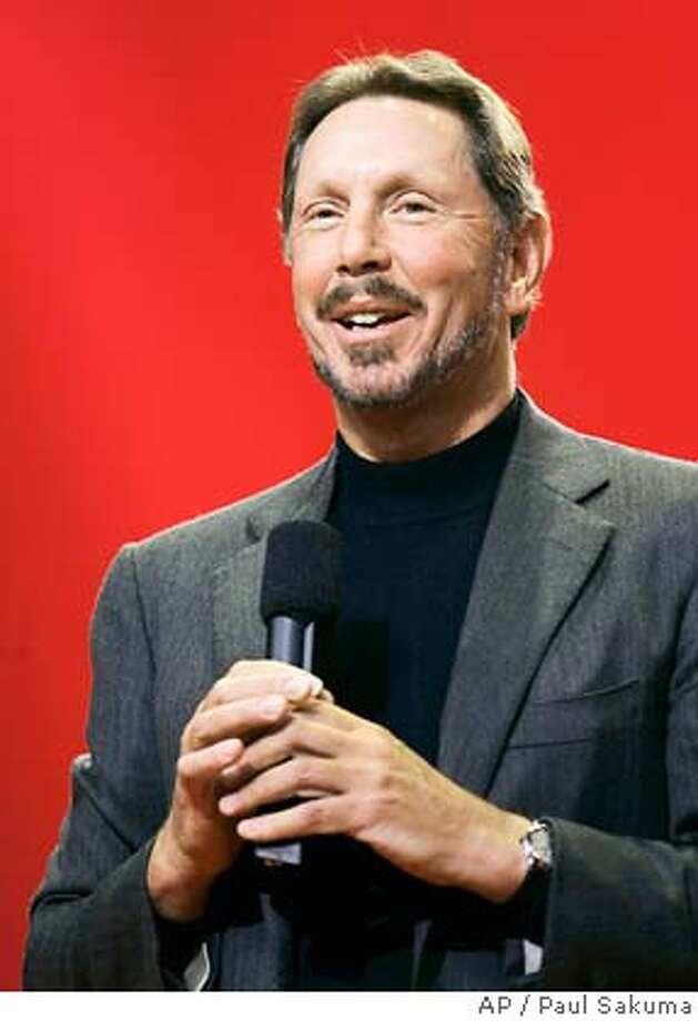 **FILE**Oracle CEO Larry Ellison smiles during his keynote address at Oracle Open World conference in San Francisco, in this Oct. 25, 2006 file photo. NetSuite Inc., an online software service controlled by Ellision, filed its papers for its long-anticipated initial public offering of stock. (AP Photo/Paul Sakuma, file) OCT. 25, 2006 FILE PHOTO Photo: Paul Sakuma