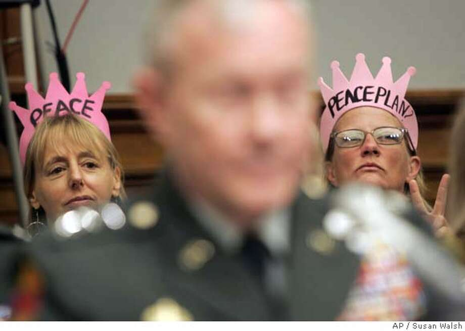 Protestors from Code Pink listen during testimony from Army Lt. Gen. Martin Dempsey, commander of the Multi-National Security Transition Command in Iraq, as he testifies on Capitol Hill in Washington, Tuesday, June 12,2007, before the House Oversight and Investigations subcommittee hearing on the Iraqi security forces. (AP Photo/Susan Walsh) Photo: Susan Walsh