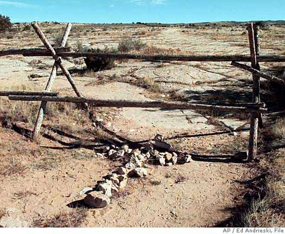 ADVANCE FOR WEEKEND EDITIONS OCT. 23-24--FILE--A cross made of stones rests below the fence in Laramie, Wyo., in this file photo taken Saturday, Oct. 9, 1999, where over a year ago gay Wyoming student Matthew Shepard was tied and pistol whipped into a coma. He later died. The opening statements in the trial for the remaining suspect, Aaron McKinney, is scheduled to begin Monday. (AP Photo/Ed Andrieski, File) Ran on: 07-12-2007 The fence on which Matthew Shepard hung for 18 hours before he was found became a monument until the property owner took it down.