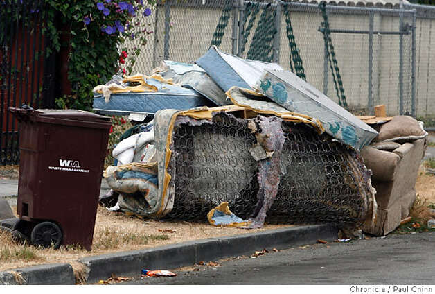 Garbage and debris continues to pile up on Birch Street near 98th Avenue in Oakland, Calif. on Wednesday, July 11, 2007. A labor dispute between Waste Management Inc., who locked-out employees, is into its second week.  PAUL CHINN/The Chronicle Photo: PAUL CHINN