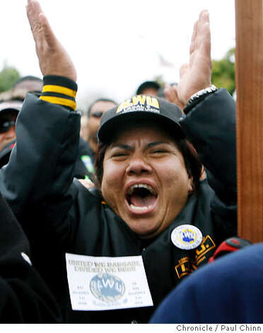 Supporter Margarita Ortiz cheers during a Teamsters rally for locked-out sanitation workers at a Waste Management Inc. transfer station in San Leandro, Calif. on Wednesday, July 11, 2007.  PAUL CHINN/The Chronicle  **Margarita Ortiz Photo: PAUL CHINN