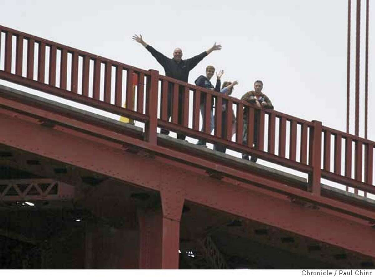 Supporters standing on the Golden Gate Bridge wave to Roz Savage while she prepares for her rowing adventure on the Pacific Ocean in Sausalito, Calif. on Tuesday, July 10, 2007. Savage, who successfully rowed her vessel solo across the Atlantic Ocean in 2006, hopes to embark on the first leg of her solo journey, a three-month trek to Hawaii, sometime Thursday night. PAUL CHINN/The Chronicle **Roz Savage MANDATORY CREDIT FOR PHOTOGRAPHER AND S.F. CHRONICLE/NO SALES - MAGS OUT