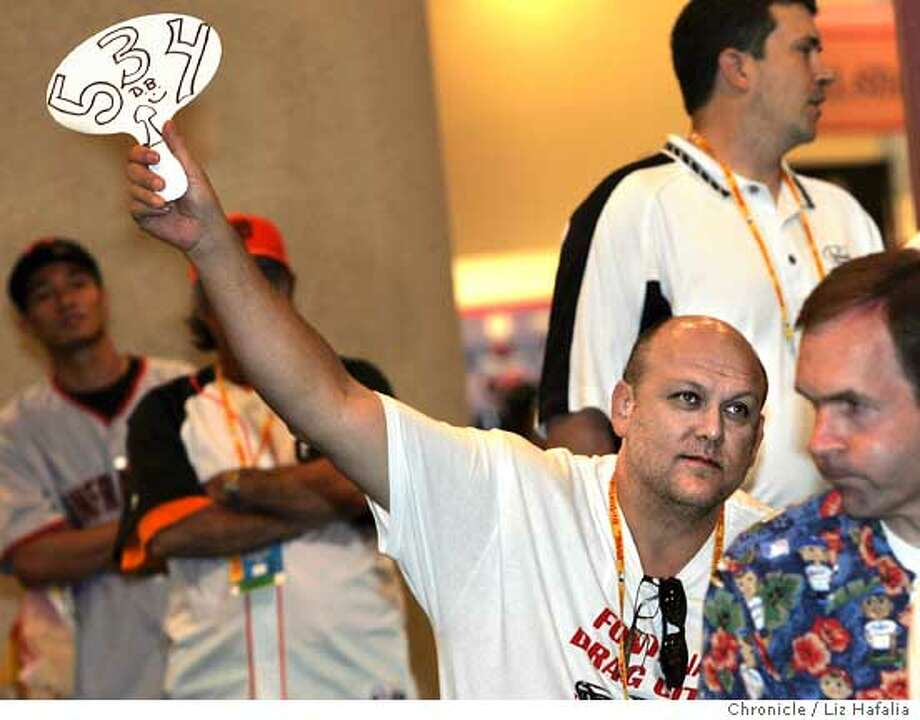 FANFEST_AUCTION_009_LH_.JPG Dave Bushing from Chicago spent all of the morning and some of the afternoon bidding on some items at the MLB Live Auction at the 2007 DHL All-Star FanFest at Moscone West in San Francisco. He did some authenticity and appraisal for this auction  Liz Hafalia/The Chronicle/San Francisco/7/10/07  **Dave Bushing cq Ran on: 07-11-2007  The bidding was fast and furious at the baseball memorabilia auction Tuesday at the All-Star FanFest in San Francisco. Dave Bushing of Chicago spent all morning and part of the afternoon bidding on auction items.  Ran on: 07-11-2007 Ran on: 07-11-2007 Photo: Liz Hafalia