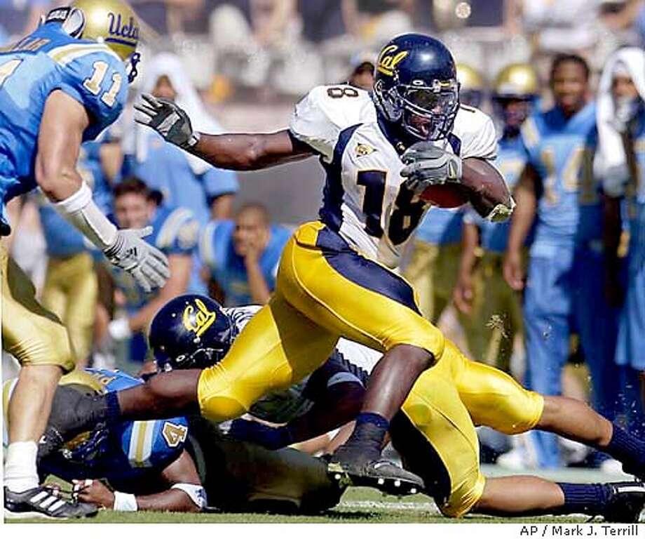 California's Adimchinobe Echemandu rushes past UCLA's Brandon Chillar during the first half Saturday, Oct. 18, 2003, in Pasadena, Calif. (AP Photo/Mark J. Terrill) Photo: MARK J. TERRILL