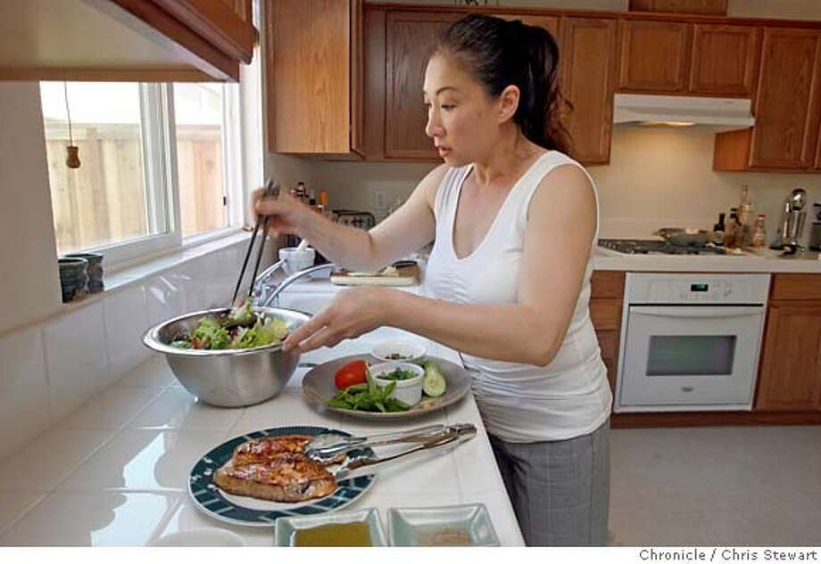 chef20_0044_cs.jpg Event on 5/7/07 in Richmond.  Vanessa Dang (cq - misspelled on photoassignment) prepares salmon salad in her Richmond home. Vanessa run's Vanessa's Bistro, 1715 Solano Street, Berkeley. Photographed May 7, 2007. Chris Stewart / San Francisco Chronicle Vanessa Dang MANDATORY CREDIT FOR PHOTOG AND SF CHRONICLE/NO SALES-MAGS OUT Photo: Chris Stewart