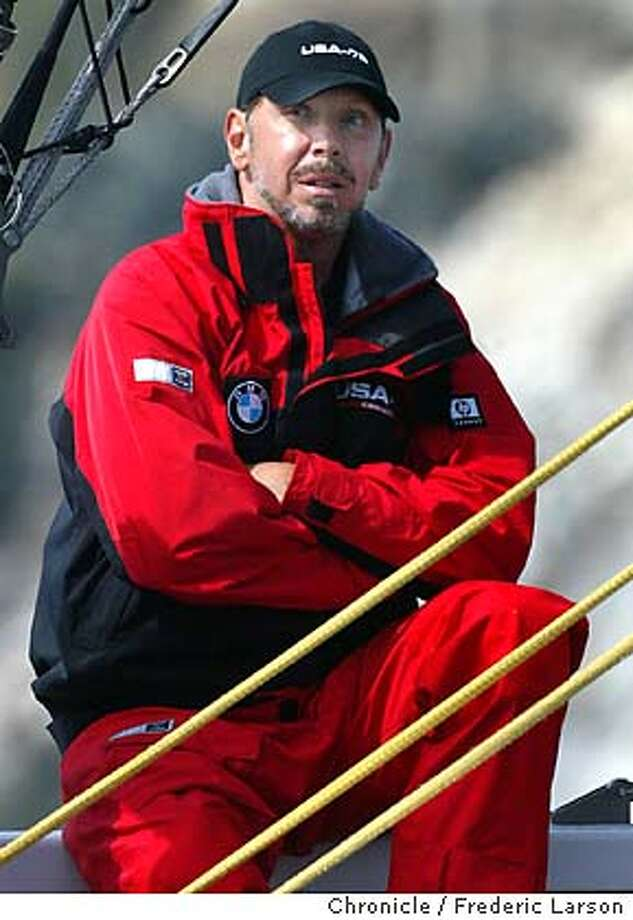 Amercia's Cup class racing returned to the U.S and the Bay Area as the cup winning Swiss team ALINGHI took on Bay Area's , ORACLE BMW racing team. Larry Ellison is at the helm (in photo) of the Oracle racing team , against his friend and rival, Ernesto Bertarelli, skipper of the Alinghi. Oracle won the first race of a pair racing today. 09/11/03 FREDERIC LARSON / The Chronicle Photo: FREDERIC LARSON