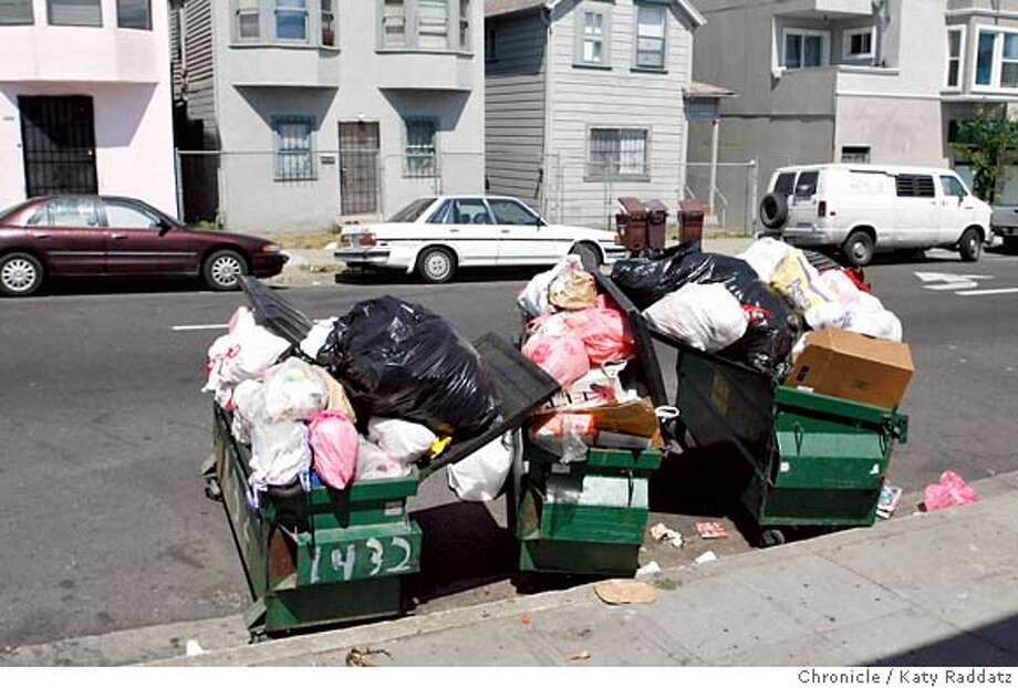 {filename  SHOWN: Overflowing bins on East 15th St. in East Oakland. We go to neighborhoods to find that garbage is NOT being collected. (Katy Raddatz/The Chronicle)  ** Mandatory credit for the photographer and the San Francisco Chronicle. No sales; mags out. Photo: Katy Raddatz