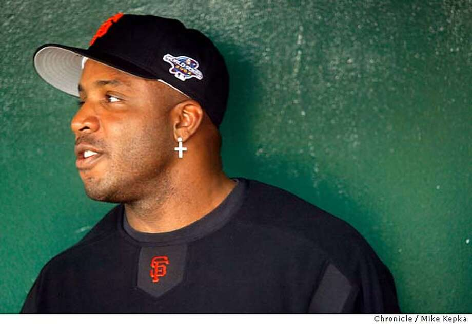 Giants Barry Bonds sits in the dugout during the Giants team workout October 18, 2002. The San Francisco Giants vs. the Anaheim Angels in the World Series with games one and two being played in Anaheim. Mike Kepka/San Francisco Chronicle  RUNCHASE Photo: Mike Kepka