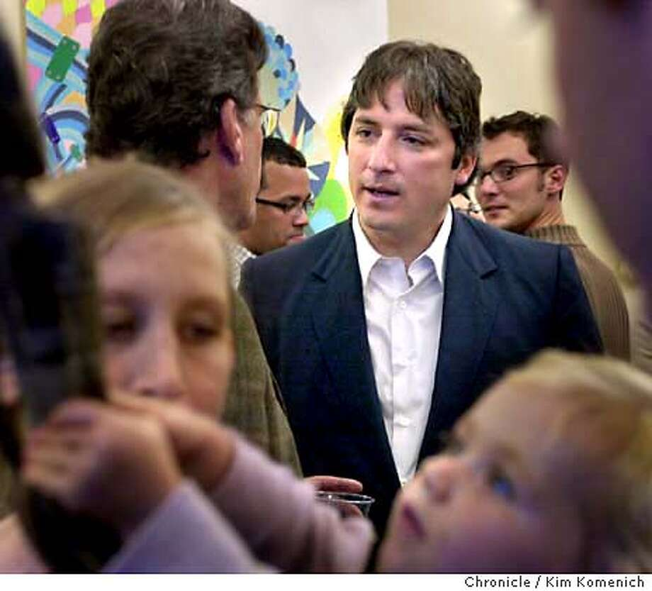 10/3/03 in San Francisco.  Gonzalez, center, facing camera, talks with colleagues and attendees.  Profile of S.F. Mayoral candidate Matt Gonzalez. We drop in on a reception for artist Rebecca Miller at Gonzalez's Supes President office.Her paintings will hang in Gonzalez's office during the month of October. KIM KOMENICH / The Chronicle Photo: KIM KOMENICH
