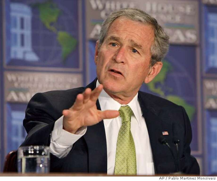 President Bush gestures as he speaks at the White House Conference on the Americas, Monday, July 9, 2007 in Arlington, Va. (AP Photo/Pablo Martinez Monsivais) Photo: Pablo Martinez Monsivais