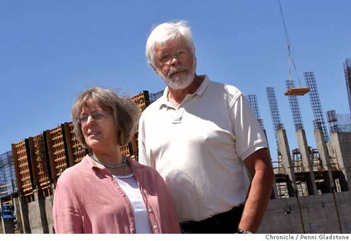 SONOMASTATE_034_PG.JPG Noel Byrne and Susan Moulton are among the faculty who have led a no-confidence vote in the campus president of Sonoma State. They stand next to the controversial new music center. Nearly 10 years after the idea for a world-class music center was conceived by Sonoma State President Ruben Arminana, the price tag has ballooned from $50 million to well over $100 million and the building is still only a quarter built at most � and can�t be finished until at least another $22 million has been raised. What is now considered a boondoggle by many at this far-flung campus in the green fields of wine country has spawned anger among faculty who feel that the president�s priorities are not in line with the university�s academic mission. Event on 6/27/07 in Rohnart Park. Penni Gladstone / The Chronicle MANDATORY CREDIT FOR PHOTOG AND SF CHRONICLE/NO SALES-MAGS OUT