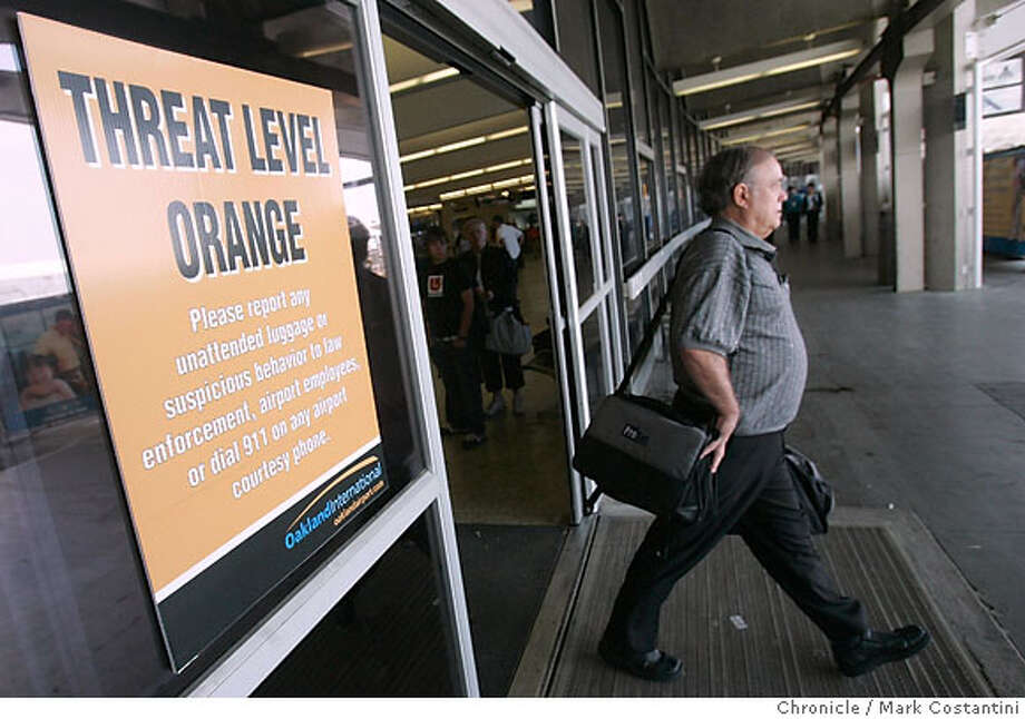 Orange security trheat level alert sign posted at the Oakland Airport. The airort was subject to a security action earlier in the day. PHOTO: Mark Costantini / The Chronicle Photo: MARK COSTANTINI