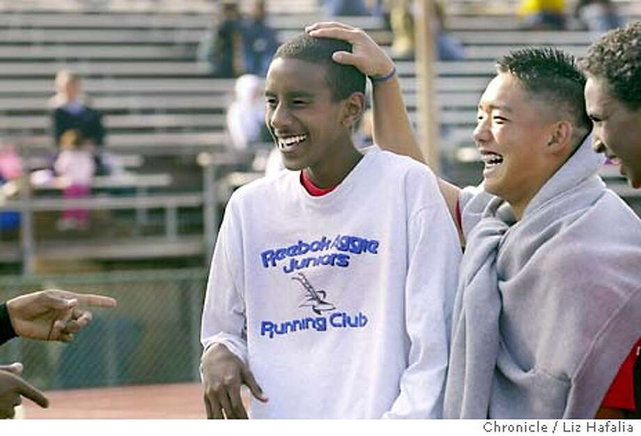 Feature on members of the James Logan High School track team. Yosef Ghebray with his teammates after the race. Shot on 5/16/03 in Union City. LIZ HAFALIA / The Chronicle Photo: LIZ HAFALIA