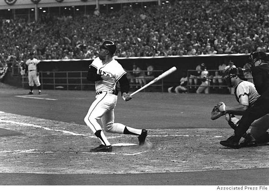 San Francisco Giants' Willlie Mays watches his single in the first inning of the All-Star game which accounted for the only run in the National League's 1-0 victory July 9,1968 in Houston,Texas. Mays went to second on a pickoff attempt and then to third on a wild pitch, socoring on a double play. Catcher is Bill Freehan of Detroit and Umpire is Shag Crawford of the National League. (AP Photo) Photo: Ap