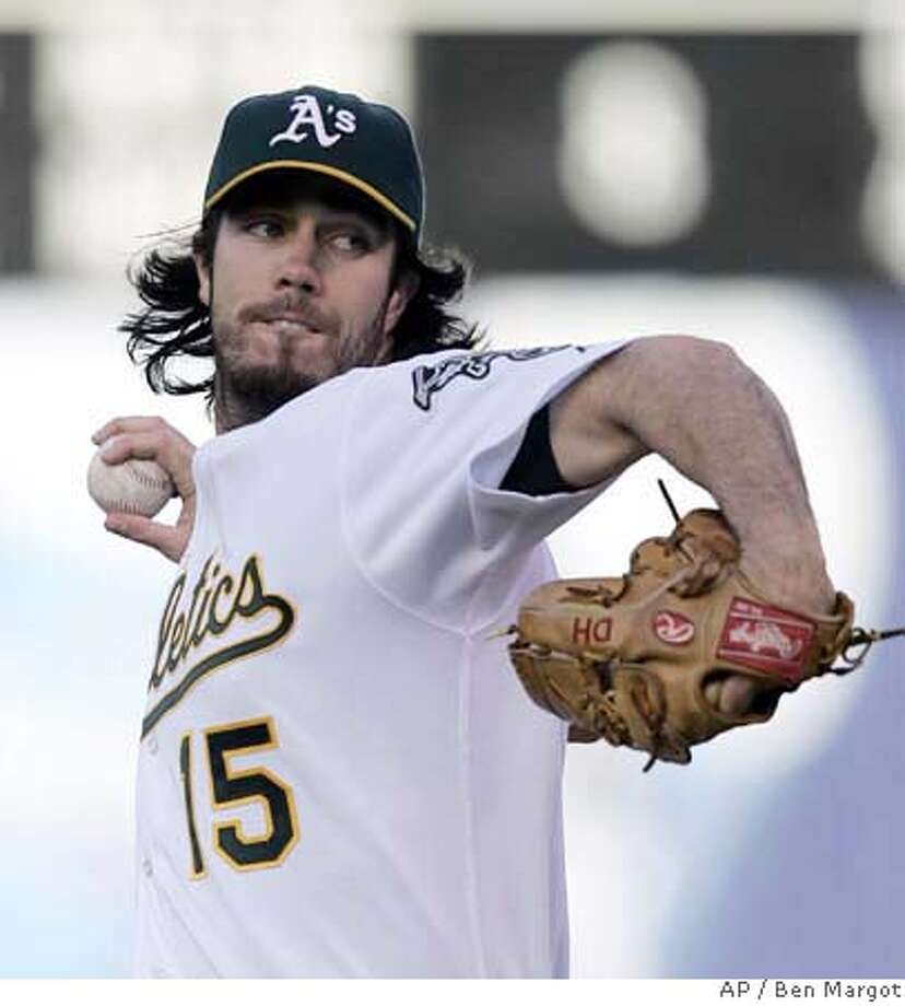 Oakland Athletics' Dan Haren works against the Seattle Mariners in the first inning of a baseball game Friday, July 6, 2007, in Oakland, Calif. (AP Photo/Ben Margot) Photo: Ben Margot