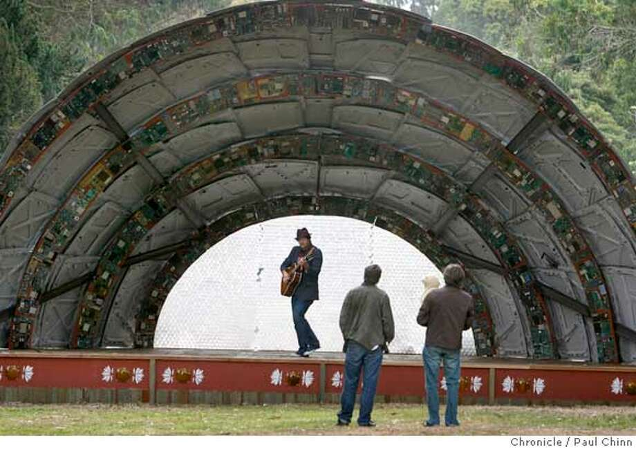 Guitarist Josh Seidenfeld performs in front of Dreux Hansen (center) and Marc Brown (right) at the Panhandle Bandshell near Golden Gate Park in San Francisco, Calif. on Saturday, July 7, 2007. Several local arts groups constructed the stage using recycled material to educate the public about recycling and to provide musicians with a place to perform during the summer months.  PAUL CHINN/The Chronicle  **Josh Seidenfeld, Dreux Hansen, Marc Brown  Ran on: 07-09-2007  Guitarist Josh Seidenfeld performs for Dreux Hansen (center) and Marc Brown. Photo: PAUL CHINN