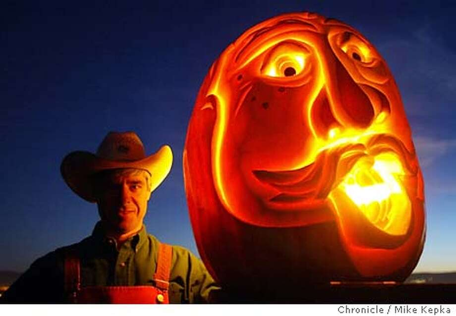 pnpumpkin170128_mk.jpg Mike Valladao of San Jose has been the official pumpkin carver at the Half Moon Bay pumkin festival. He carves 3-d faces into large pumpkins somtimes weighing over one hundred pounds. 10/10/03 in San Jose. MIKE KEPKA/The San Francisco Chronicle Photo: MIKE KEPKA