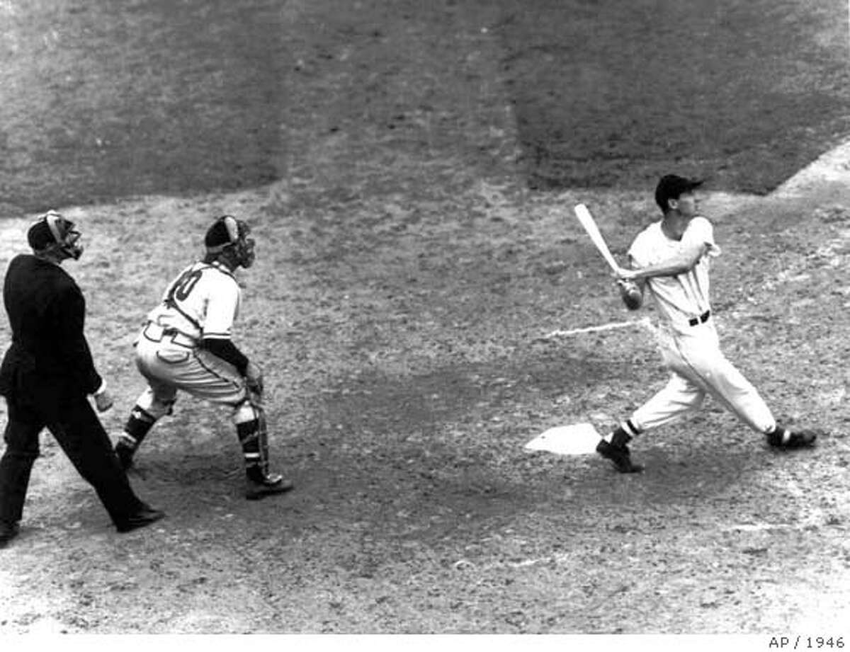 Boston Red Sox slugger Ted Williams follows flight of the ball after connecting with a Rip Sewell pitch for a home run in the eighth inning of the All-Star game between American and National Leagues at Fenway Park in Boston July 9, 1946. Massachusetts Gov. William Weld sign legislation Thursday, Dec. 14,1995, at a ceremony naming the new Boston Harbor tunnel for Williams, who will be on hand tomorrow morning when the harbor crossing is christened. (AP Photo/file) LIBRARY TAG 07121999 SPORTS ALL*STAR '99 nytredsox -- Library Tag 07062002 Sports Special Section - A Life Remembered TED WILLIAMS FAREWELL, JULY 6TH, 2002. B&W Daily SPECIAL TO BOSTON GLOBE