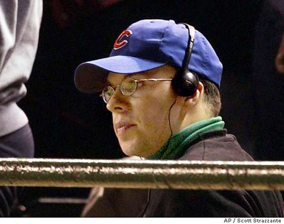 Chicago Cubs fan Steve Bartman sits in the stands at Wrigley Field in Chicago during the eighth inning of Game 6 of the NLCS between the Chicago Cubs and the Florida Marlins Tuesday, Oct. 14, 2003. Earlier in the inning, Bartman tried to grab a foul ball, preventing Cubs outfielder Moises Alou from catching it. That helped the Florida Marlins rally for an 8-3 victory to tie the NL championship series. Bartman apologized Wednesday, Oct. 15, 2003, saying he was brokenhearted.(AP Photo/Chicago Tribune, Scott Strazzante) Photo: SCOTT STRAZZANTE