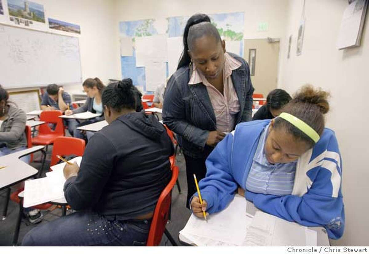 In this file photo Tahira Hodge (standing at center), a counselor at University Preparatory Charter Academy, (UPREP) monitors students as they take the STAR (Standardized Testing and Reporting) test in Oakland.