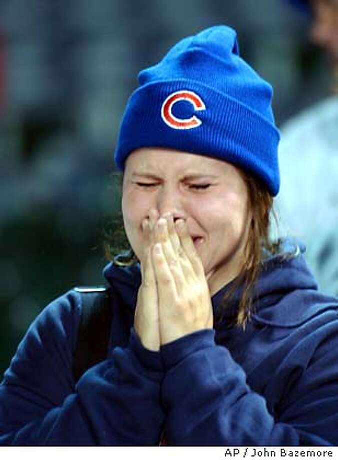 Chicago Cubs fan Jenny Naleck weeps after the Florida Marlins beat the Cubs 9-6 to win the National League pennant Wednesday, Oct. 15, 2003, at Wrigley Field in Chicago. (AP Photo/John Bazemore) Photo: JOHN BAZEMORE