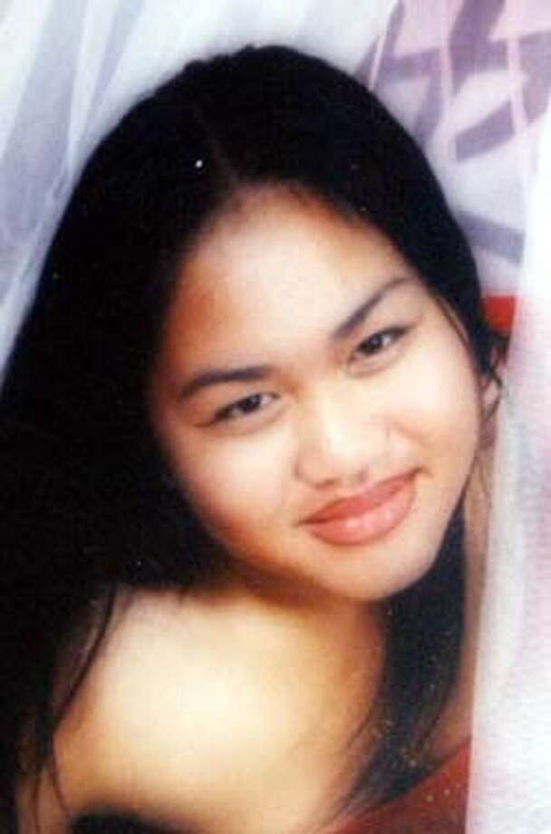 ** FILE ** This is a family photo, date and location not known, of 15-year-old Chan Boonkeut of Richmond, Calif., who was shot to death in her home Monday, Oct. 13, 2003. Police said she was shot when answering the door at her family's home. (AP Photo/The Oakland Tribune, D. Ross Cameron) Photo: D. ROSS CAMERON