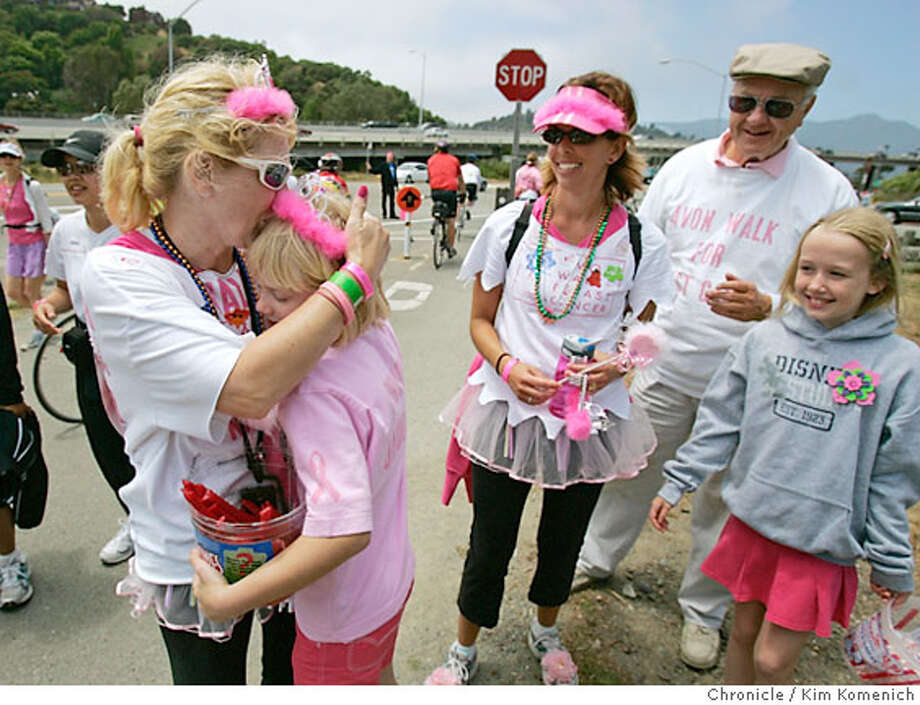 In Mill Valley Saturday Alison (cq) Otewalt-Nissen of Campbell hugs daughter Phoebe Otewalt-Nissen, 10, as Andra (cq) Fitzgerald of Brentwood, Dave Otewalt of Cupertino and Emma Thompson 9, of Santa Clara watch. Alison and Andra are participants in the fifth annual Avon Walk for Breast Cancer. Alison and Andra are walking in memory of Alison's mother and Phoebe's grandmother Louise Otewalt, wao died at age 72 from breast cancer. Dave Otewalt is expecting a call from our reporter on his cell- the number is (408) 221-8225.  Photo by Kim Komenich/The Chronicle  **Alison Otewalt-Nissen, Phoebe Otewalt-Nissen, Andra Fitzgerald, Dave Otewalt, Emma Thompson Photo: Kim Komenich