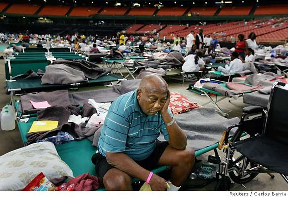 David Brown, a victim of Hurricane Katrina, sits at the Astrodome stadium where 16,000 evacuees received food and shelter in Houston, Texas September 4, 2005. The Arena is being used as an intake facility where medical care is provided and evacuees of Hurricane Katrina are evaluated for assignment to other facilities. REUTERS/Carlos Barria Ran on: 09-05-2005  Condoleezza Rice helps load supplies in Bayou La Batre, Ala. Ran on: 09-05-2005 Ran on: 07-08-2007  David Brown, displaced by Hurricane Katrina, sits in the Houston Astrodome. Many evacuees were moved there from the Superdome in New Orleans. Photo: CARLOS BARRIA