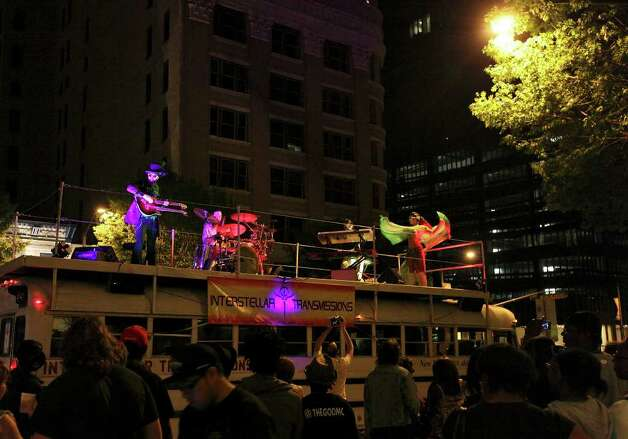 FOR METRO - Interstellar Transmissions, from Austin, performs atop a bus during South by Southwest Saturday March 17, 2012 in Austin, TX. Photo: EDWARD A. ORNELAS, EDWARD A. ORNELAS/SAN ANTONIO EXPRESS-NEWS / © SAN ANTONIO EXPRESS-NEWS (NFS)